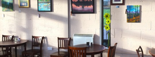 Welsh artist Christopher Langley sells work at the Terra Nova Cafe.